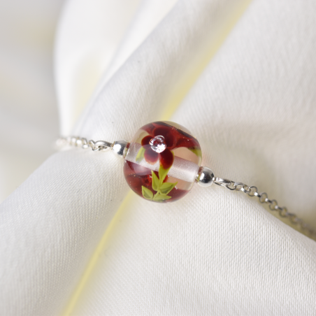 Essential bracelet with deep red...
