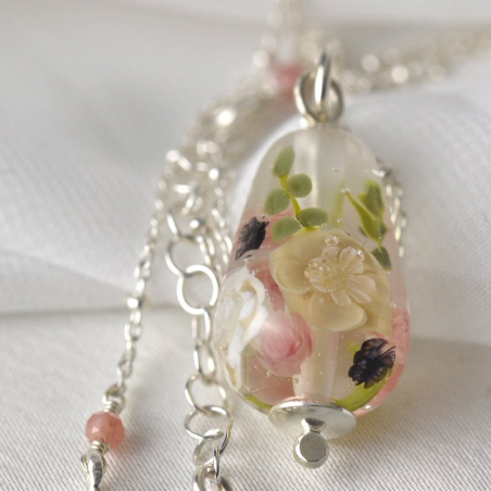 Drop necklace with a glass ivory,...